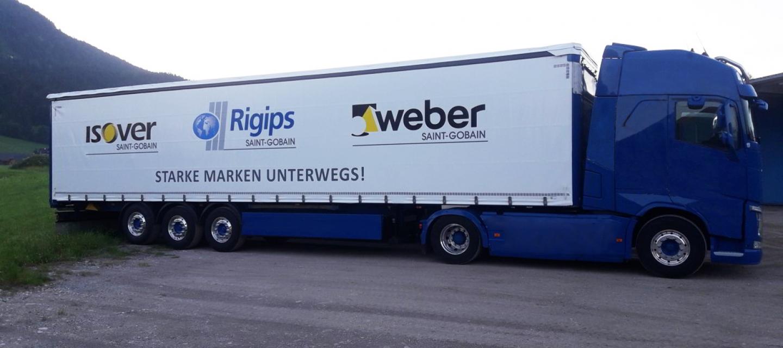Header Logistik LKW mit 3 Logos: Weber, ISOVER, Rigips